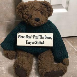 Teddy bear with sign.